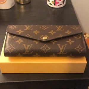 Louis Vuitton wallet, perfect condition.
